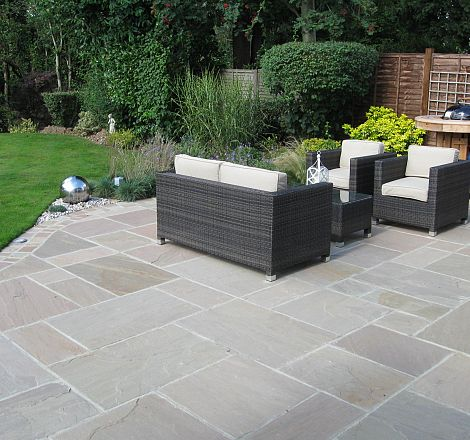 Curved patio greenspace garden design for Back garden patio designs